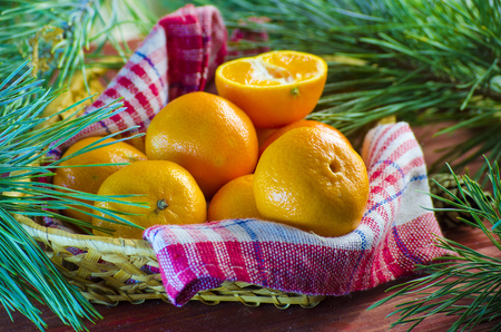 Fresh tangerines in a basket on the table