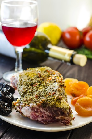 Meat with dried apricots and prunes in the wine for baking in the oven