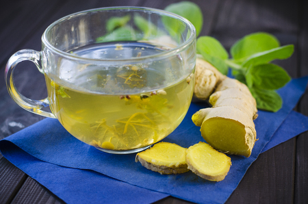 Herbal tea with mint and ginger on a wooden table Stock Photo