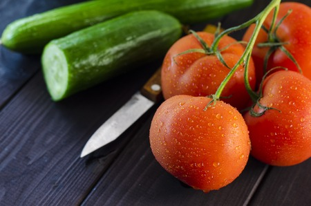 Fresh vegetables for cooking dishes on a wooden table