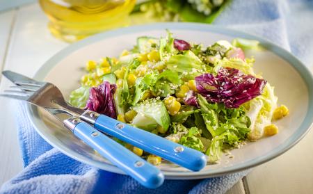 Fresh vitamin salad with corn and sesame seeds Stock Photo