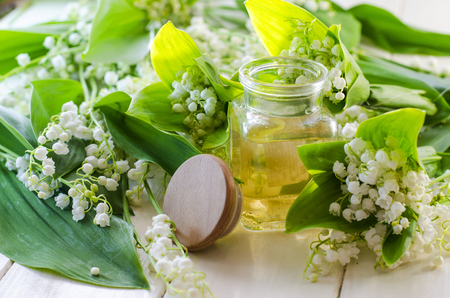 Perfumed lily of the valley oil in a bottle Stock Photo