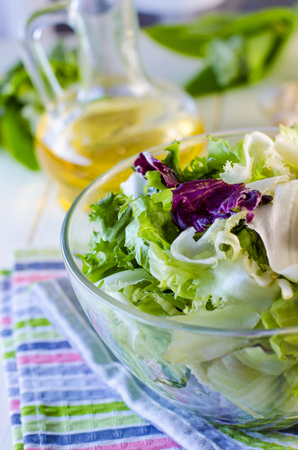 Fresh green dietary salad with spinach, rucola, and salad