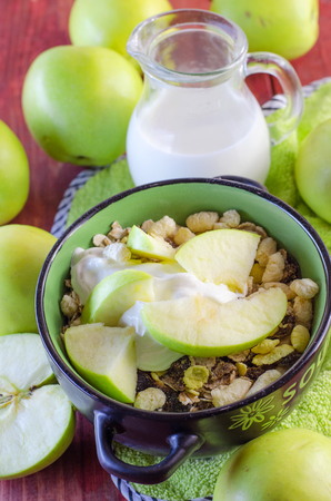 healthy breakfast of oat muesli with apples Фото со стока