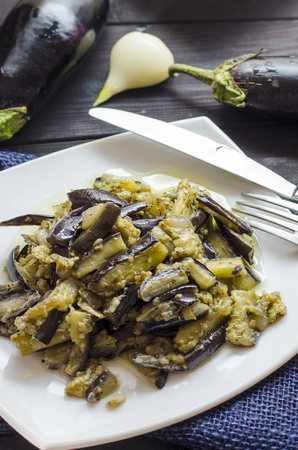 fried eggplants with garlic on a plate