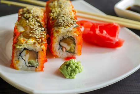 sushi california with shrimp and salmon, roll in caviar of flying fish