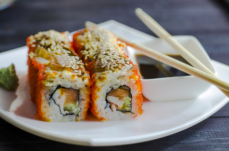 sushi rolls with eel in flying fish roe