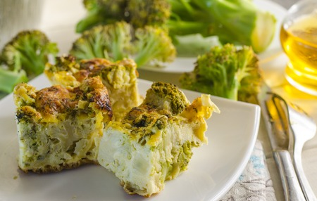 Vegetarian dietary fudge from broccoli, slices it on a plate