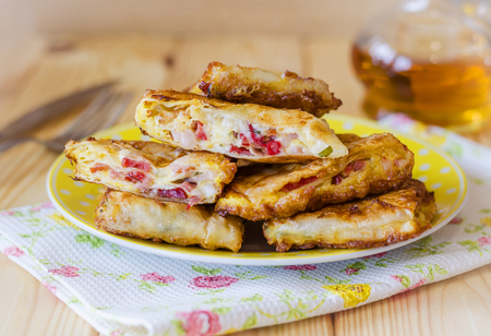 fried snack from thin lavash with stuffing of sausage and cheese Stock Photo