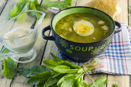 green borsch with sorrel and egg in the tureen 版權商用圖片