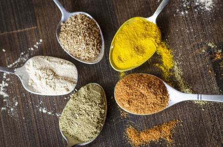 set of different spices and spices in spoons