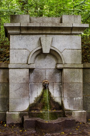 source of healing water in a beautiful old stone decoration