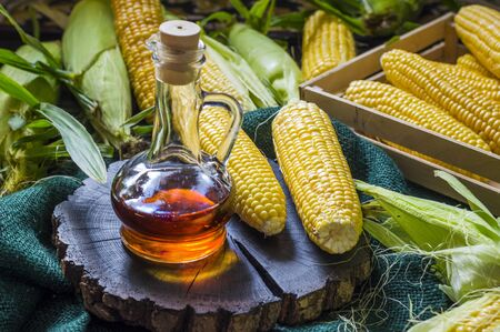 corn oil in a glass bottle and pumped corn 写真素材