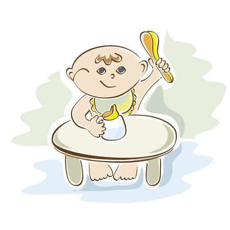 eats: little cute baby eats at the table