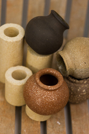 daunia: clay pots on a wooden background
