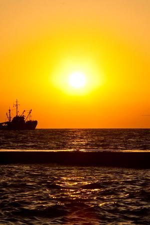 Ship out at sea at sunset. Banco de Imagens