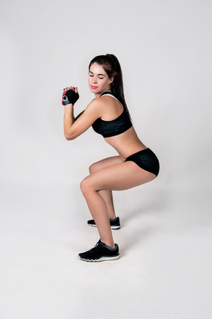 sportwear: a girl in a sportwear does the fitness of exercise on a white background Stock Photo