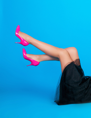 pink shoes: woman feet are in pink shoes