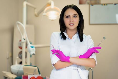portrait of a dentist doctor against the background of the office