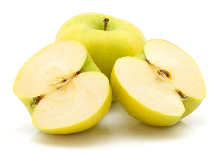 Apples (Smeralda variety) isolated on white background green yellow one whole one cut in half two cross section halves  Stock Photo