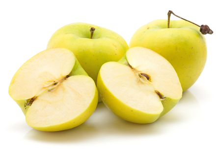 Apples (Smeralda variety) isolated on white background green yellow two whole one cut in half two cross section halves  Stock Photo