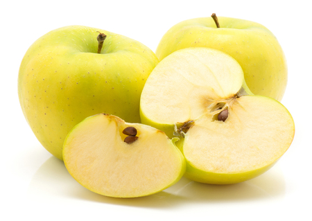 Two apples (Smeralda variety) one half and a slice isolated on white background  Stock Photo
