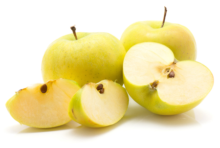 Apples (Smeralda variety) stack isolated on white background two whole green yellow one cross section half and two slices