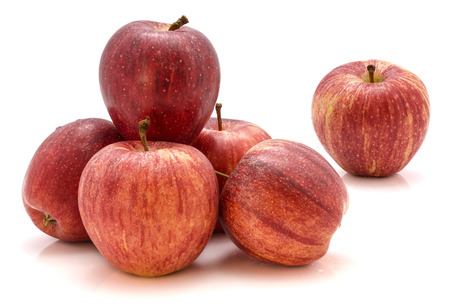 Group of whole Gala apples isolated on white background  写真素材