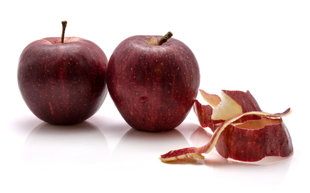 Two whole Gala apples with separated rind isolated on white background