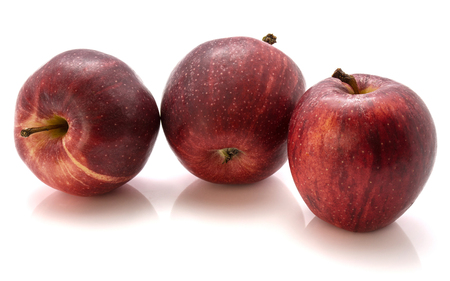 Three whole Gala apples in row isolated on white background  写真素材