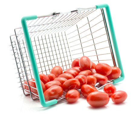 Cherry tomatoes out a shopping basket isolated on white background