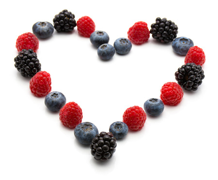 Heart by berries isolated on white background blackberry blueberry and raspberry  Stock Photo