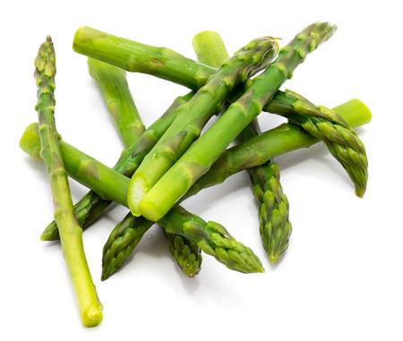 Cooked boiled asparagus heap isolated on white background