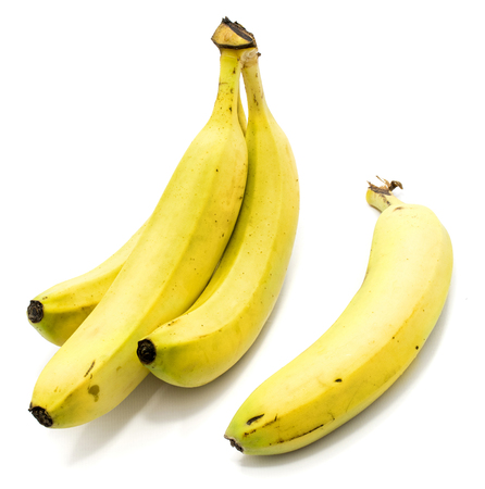 Group of yellow whole bananas isolated on white background