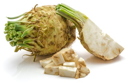 One whole bulb of fresh celery root, one quarter and chopped pieces, isolated on white background