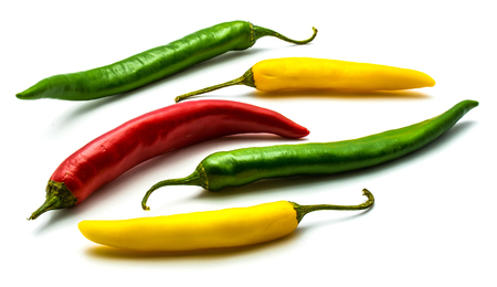 A lot of Chili peppers isolated on white background (one red, two green and yellow whole)