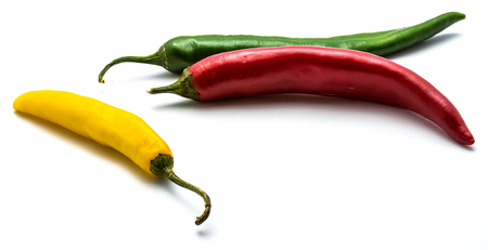 Red, green and yellow Cayenne Chili peppers isolated on white background whole  Stock Photo
