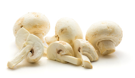 Champignons sliced isolated on white background three whole three quarters  Stock Photo