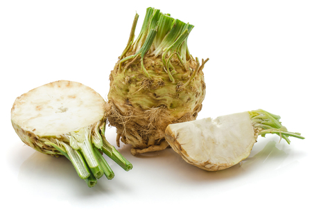 Fresh celery root isolated on white background one whole, half and quarter