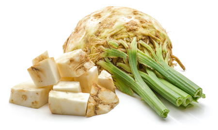 Sliced celery root pieces and one half isolated on white background