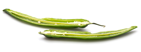 Green Chili pepper, two halves, isolated on white background  Stock Photo