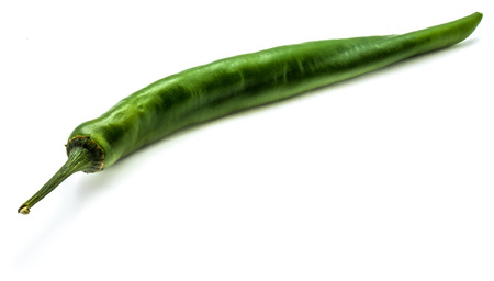 One whole Chilli pepper, green Cayenne, isolated on white background  Stock Photo
