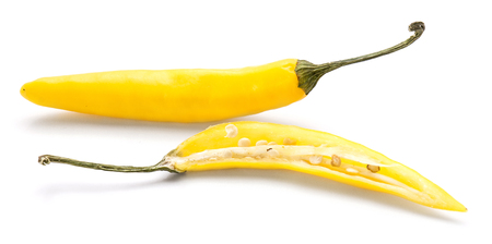 Yellow Chili pepper, one whole and sliced half, isolated on white background  Stock Photo