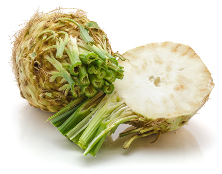 One whole and half of fresh celery root isolated on white background cross section