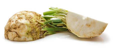 One half and quarter of fresh celery root isolated on white background