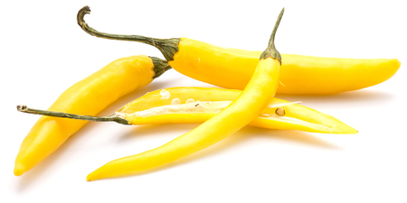 Yellow Chili peppers, two whole and one sliced, two halves, isolated on white background  Stock Photo