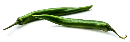 Two whole Chili peppers, green Cayenne, isolated on white background