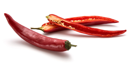 One whole red Chili pepper and two halves isolated on white background