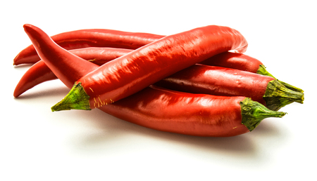Group of four red Chili peppers isolated on white background
