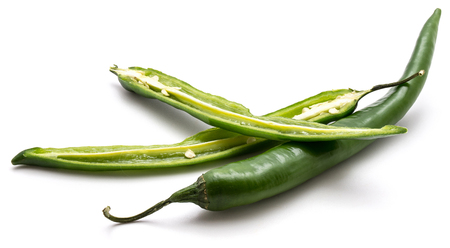 Green Chili peppers, one whole and two halves, isolated on white background  Stock Photo